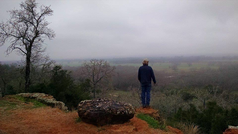 Author Bobby Horecka gazing off into a misty horizon.